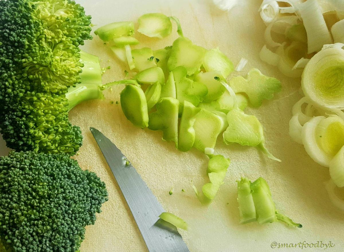 Cutting broccoli trunks.