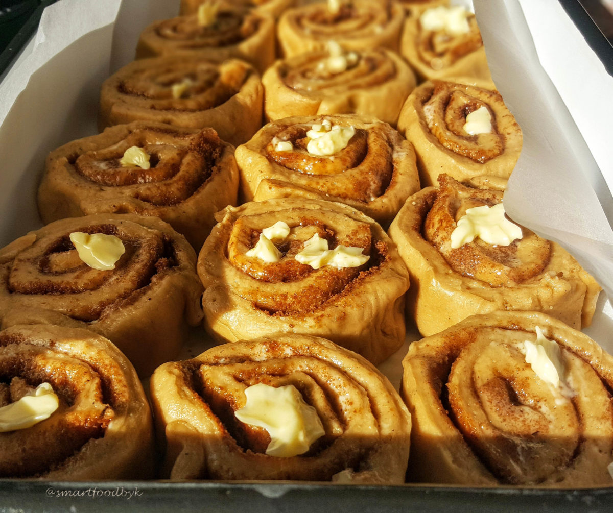 Cinnamon rolls after 15-minute rising under a kitchen towel.