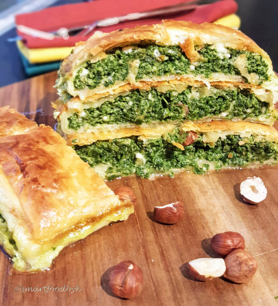 Spinach puff pastry roll with ricotta and hazelnuts