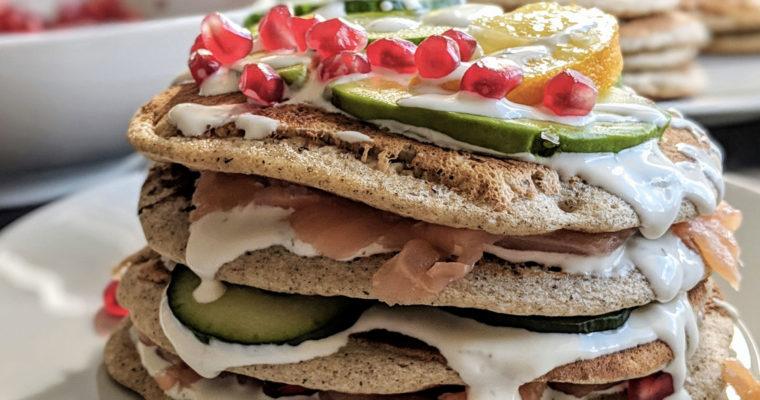 Savoury pancakes with salmon, cucumber, avocado & pomegranate