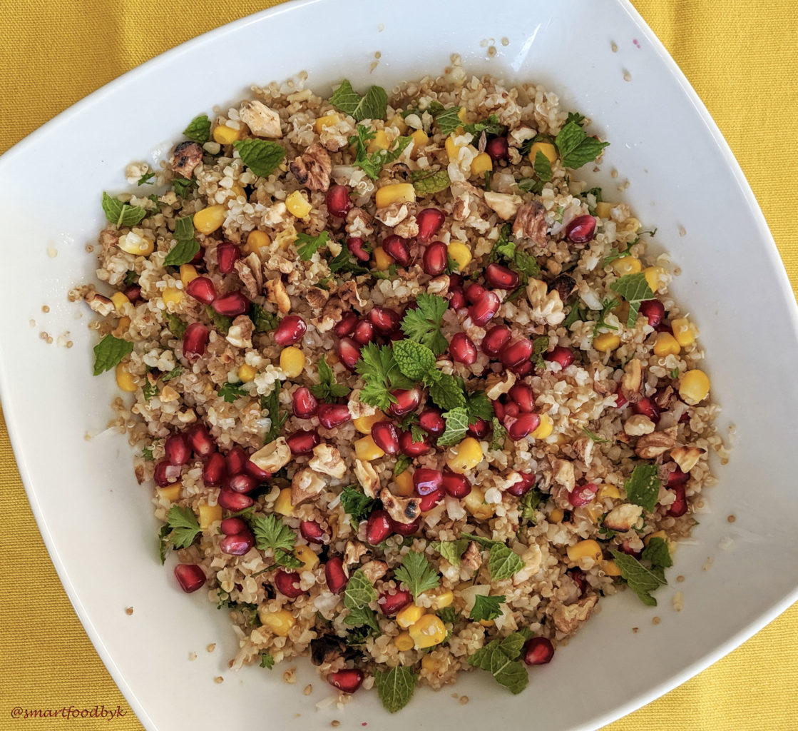 Sweet corn, pomegranate, bulgur and quinoa salad