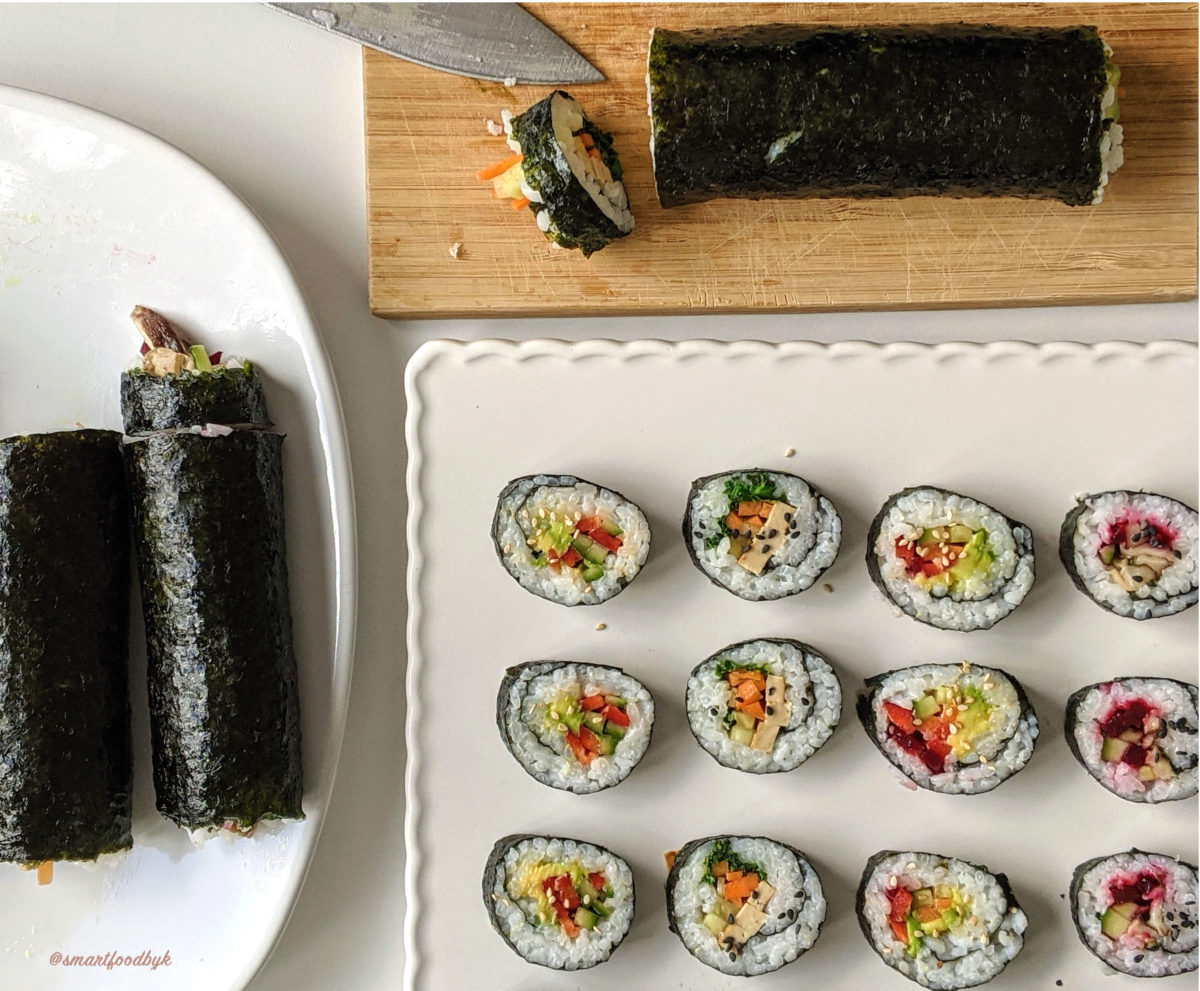 Cutting the the homemade sushi rolls.