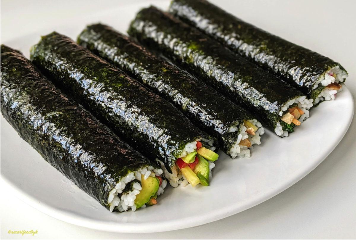 Vegan sushi rolls ready to cut.
