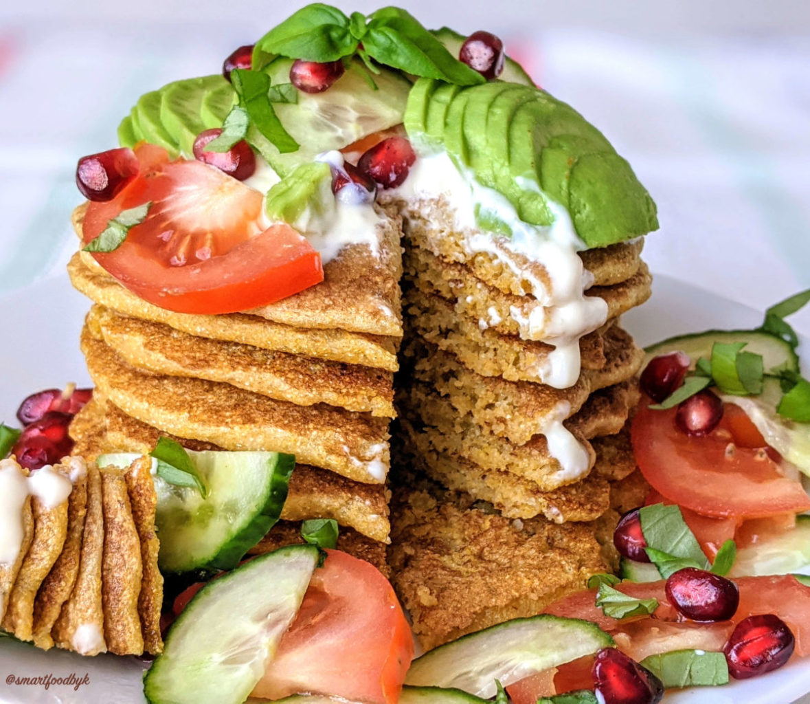Savoury corn pancakes cut with toppings.